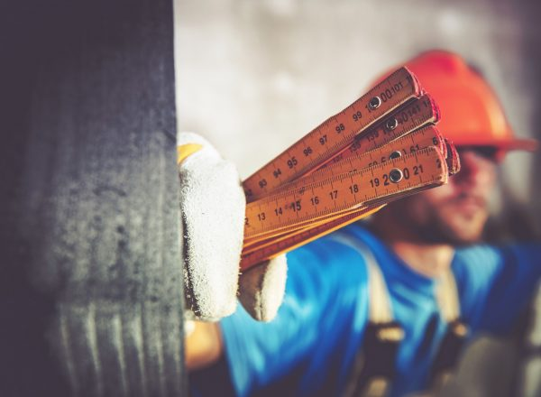 Worker with Measuring Tool